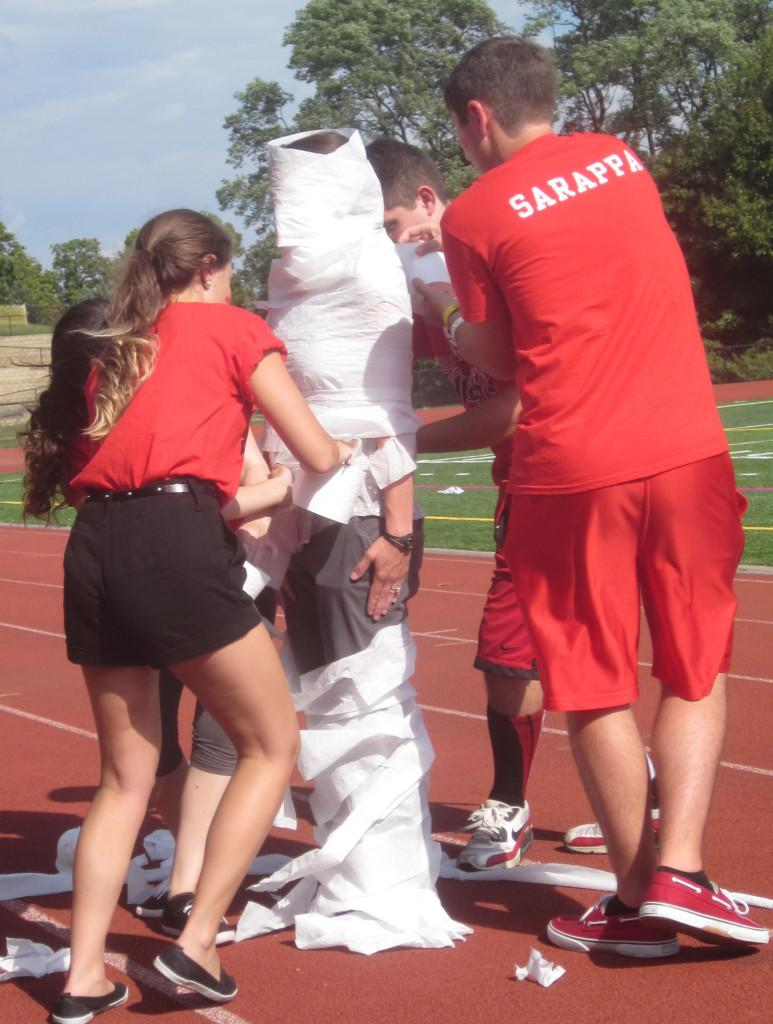 Seniors finishing up the toilet paper competition with a complete mummy-teacher