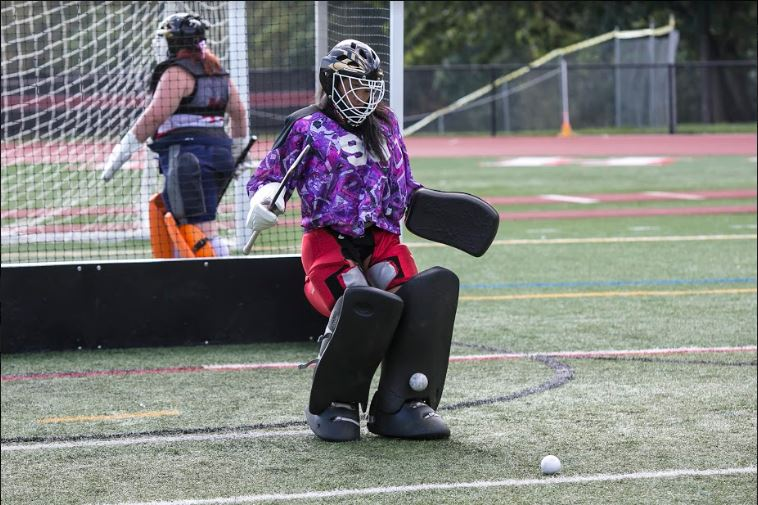 Field Hockey goalie ready to stop the opposing team from scoring
