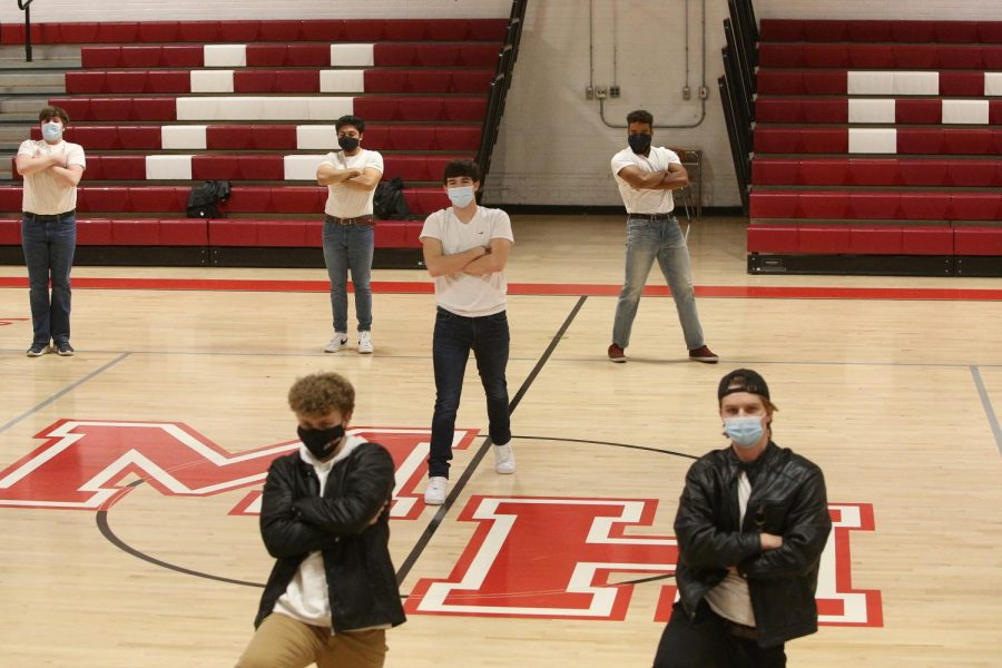 This year's Mr. Morris Hills candidates practice in the gym.