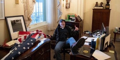 Rioter puts his feet up on Speaker of the House,  Nancy Pelosi's desk. He proceeded to steal Pelosi's mail. Photo taken by Saul Loeb.